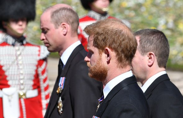 Prince William, Duke of Cambridge; Prince Harry, Duke of Sussex and Peter Phillips walk behind Prince Philip, Duke of Edinburgh's coffin, carried by a Land rover hearse, in a procession during the funeral of Prince Philip, Duke of Edinburgh at Windsor Castle on April 17, 2021 in Windsor, United Kingdom