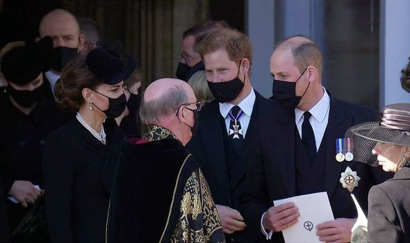 Prince William and Harry talk outside the funeral