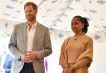Doria Ragland standing next to Prince Harry (Image: GETTY IMAGES)