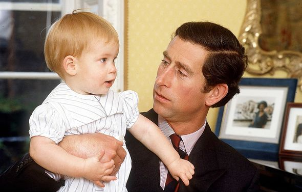 Prince Charles With Prince Harry, aged one, at home in Kensington Palace.(Image: Getty)