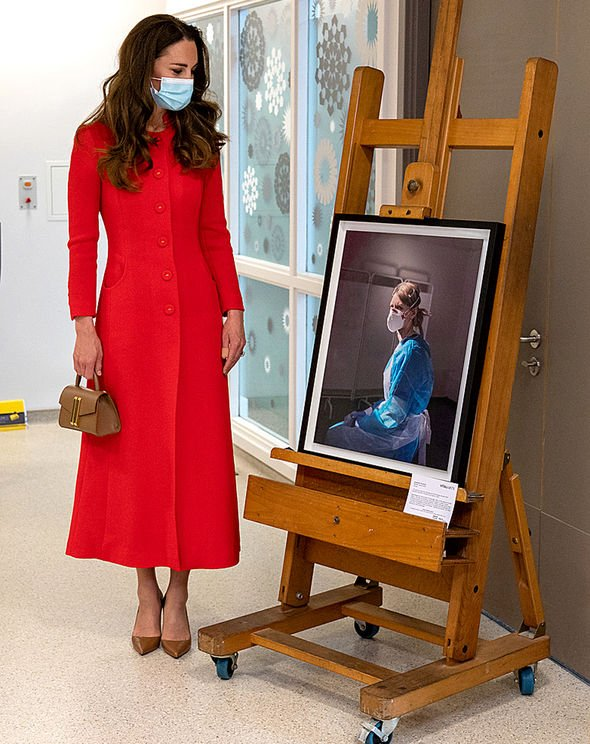 Kate with the book's cover picture at the Royal London Hospital(Image: NC)