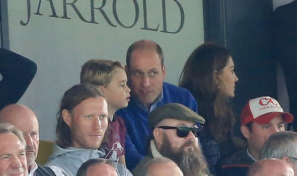 William introducing his son George to football