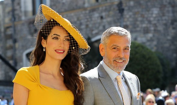 George and Amal Clooney at Meghan and Harry's wedding(Image: GETTY)