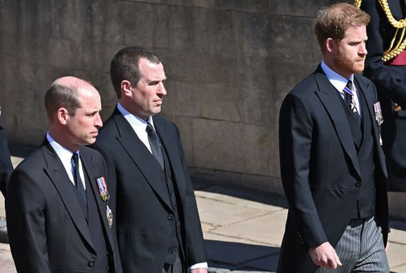 Prince Harry and Prince William, separated by cousin Peter Phillips, at the Duke's funeral(Image: GETTY)