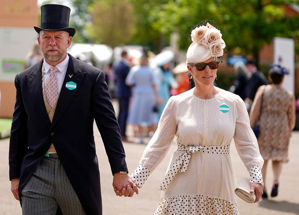 Zara Tindall and Mike looked loved-up as they walked around the racecourse(Image: GETTY)