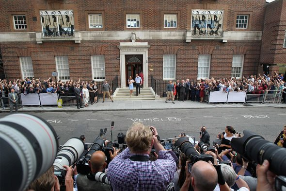 Kate and William being photographed by the press