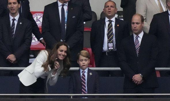Kate kneels down to speak to Prince George.