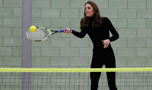 Picture of Kate Middleton playing tennis at a school