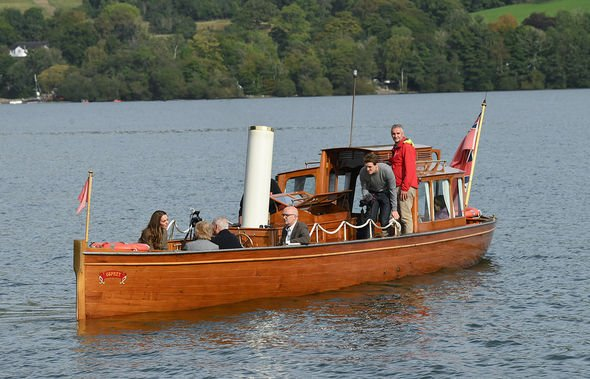 Catherine, Duchess of Cambridge embarks on a boat trip with two of the 'Windermere Children', a group of 300 child Holocaust survivors who came to sta