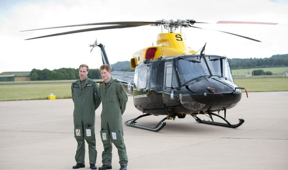 Picture of Princes William And Harry outside a helicopter