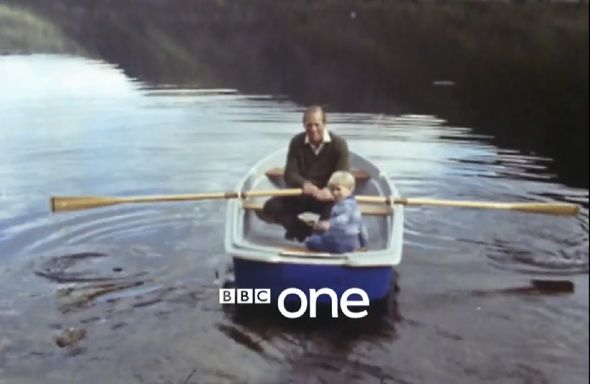Prince Philip and Prince Edward on a row boat