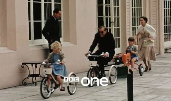Prince Philip larks around on a tricycle