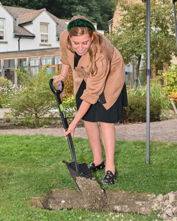 Princess Beatrice burying a time capsule at hospice event