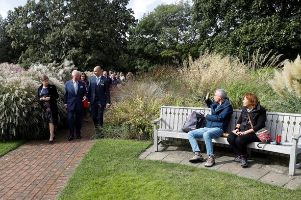 Shocked visitors were even snapped waving to the future King as he passed them on their picnic.