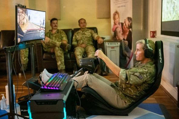 Sophie looked focused as the khaki-wearing royal tried her hand at gaming during a visit to RAF Wittering for the Wessex Cup.