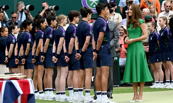 Kate at Wimbledon speaking to the ball boys and girls