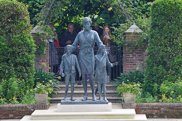 File photo dated 2/7/2021 of members of the public view the statue of Diana, Princess of Wales, in the Sunken Garden at Kensington Palace, London