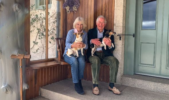 Camilla Charles and rescue dogs