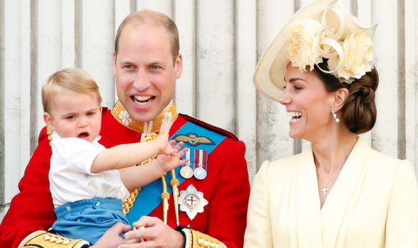 William holds his youngest son, Prince Louis, in 2019