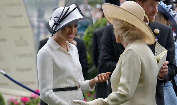 Meghan Markle speaking with Camilla